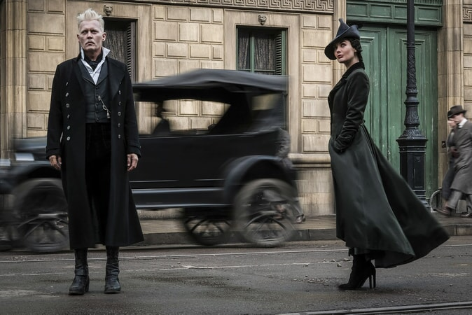 "JOHNNY DEPP as Gellert Grindelwald and POPPY CORBY-TUECH as Vinda Rosier, one of Grindelwald's most trusted followers, a loyal servant to his cause and often at his side, in Warner Bros. Pictures' fantasy adventure ""FANTASTIC BEASTS: THE CRIMES OF GRINDELWALD,"" a Warner Bros. Pictures release. Photo by Jaap Buitendijk"