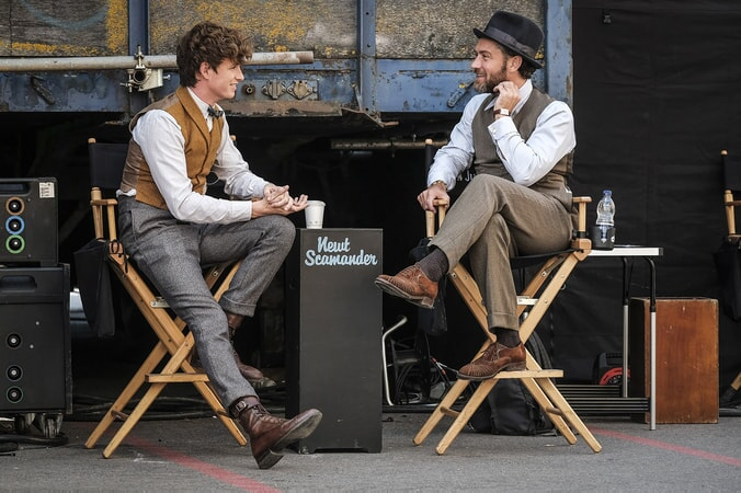 "JUDE LAW and EDDIE REDMAYNE behind the scenes on Warner Bros. Pictures' fantasy adventure ""FANTASTIC BEASTS: THE CRIMES OF GRINDELWALD,"" a Warner Bros. Pictures release. Photo by Jaap Buitendijk"