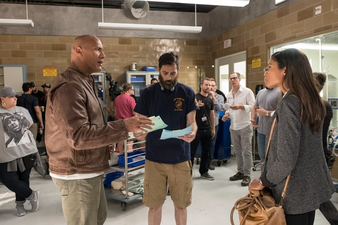 "(Front L-R) DWAYNE JOHNSON, director/producer BRAD PEYTON and NAOMIE HARRIS on the set of New Line Cinema's and ASAP Entertainment's action adventure ""RAMPAGE,"" a Warner Bros. Pictures release."