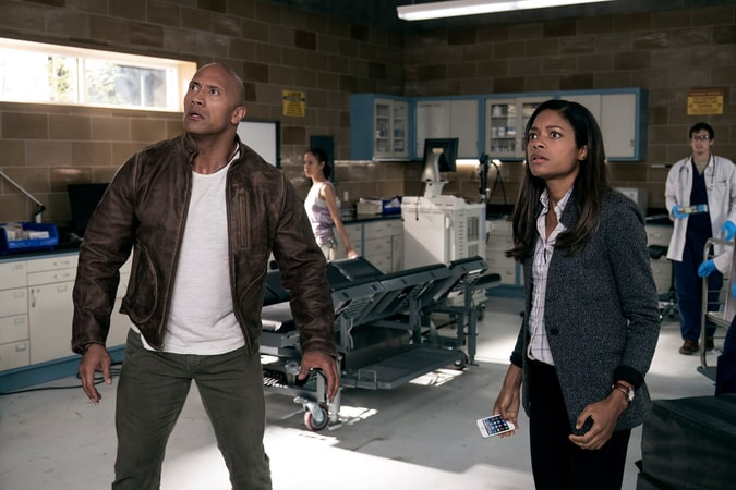 "DWAYNE JOHNSON as Davis Okoye and NAOMIE HARRIS as Dr. Kate Caldwell in New Line Cinema's and ASAP Entertainment's action adventure ""RAMPAGE,"" a Warner Bros. Pictures release."