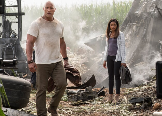 "DWAYNE JOHNSON as Davis Okoye and NAOMIE HARRIS as Dr. Kate Caldwell in New Line Cinema's action adventure ""RAMPAGE,"" a Warner Bros. Pictures' release."