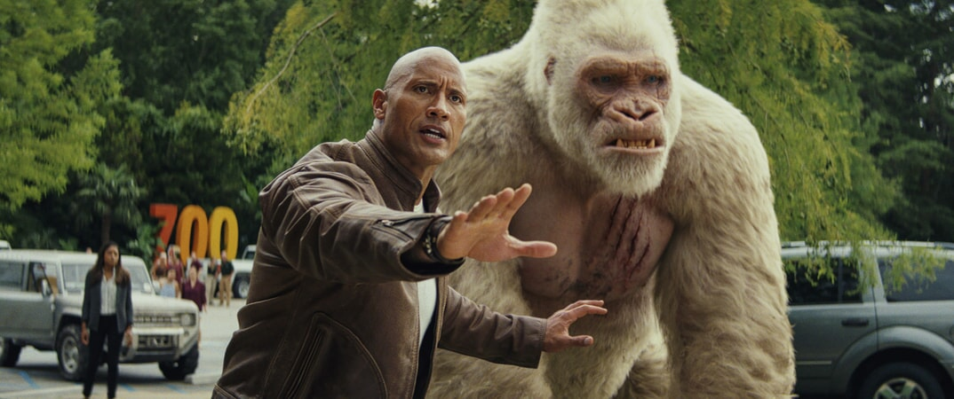 "(L-R) DWAYNE JOHNSON as Davis Okoye and JASON LILES as George in New Line Cinema's and ASAP Entertainment's action adventure ""RAMPAGE,"" a Warner Bros. Pictures release."