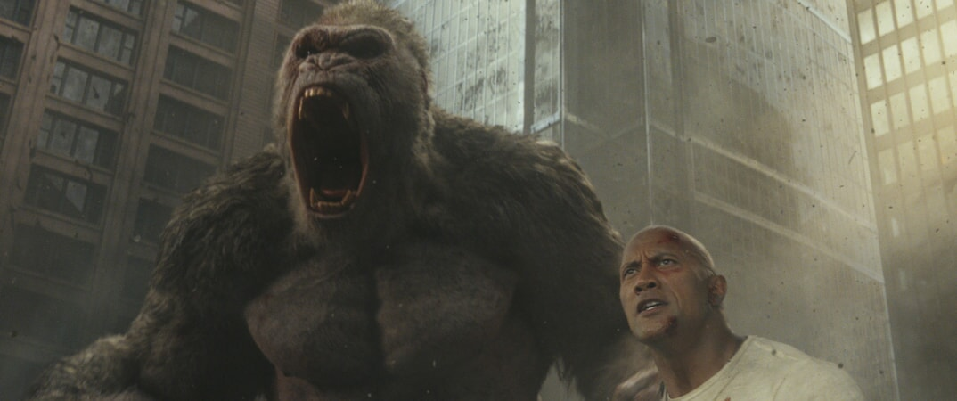 "(L-R) JASON LILES as George and DWAYNE JOHNSON as Davis Okoye in New Line Cinema's and ASAP Entertainment's action adventure ""RAMPAGE,"" a Warner Bros. Pictures release."