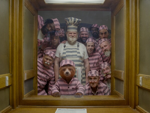 (Left side top-bottom) VIRGILE ELANA as Charley Rumble, AARON NEIL as Spoon, ROBERT STEVENSON as Jimmy the Snitch, GEOFF BANKS as Squeaky Pete and DEEPAK ANAND as Mad Dog; (Center top-bottom) BRENDAN GLEESON as Knuckles McGinty and Paddington voiced by BEN WHISHAW; (Right side top-bottom) EMERSON NWOLIE as Double Bass Bob, JAMIE DEMETRIOU as The Professor, TOM DAVIS as T-Bone, NOAH TAYLOR as Phibs, STEPHEN MCDADE as Jonny Cashpoint, NICHOLAS LUMLEY as Farmer Jack and CAL McCRYSTAL as Sir Geoffrey Wilcott in