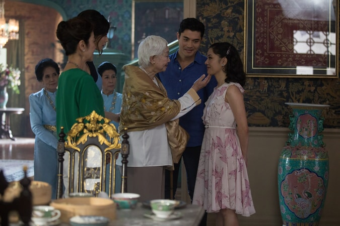 "(L-R) MICHELLE YEOH as Eleanor, GEMMA CHAN as Astrid, LISA LU as Ah Ma, HENRY GOLDING as Nick and CONSTANCE WU as Rachel in Warner Bros. Pictures' and SK Global Entertainment's contemporary romantic comedy ""CRAZY RICH ASIANS,"" a Warner Bros. Pictures release."