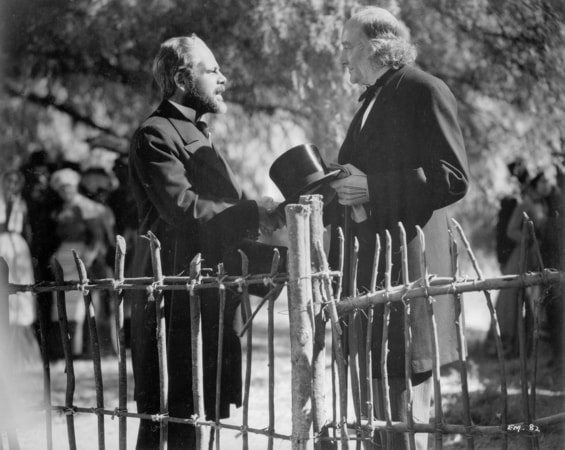 Paul Muni as Louis Pasteur shaking hands with Halliwell Hobbes as Dr. Lister.