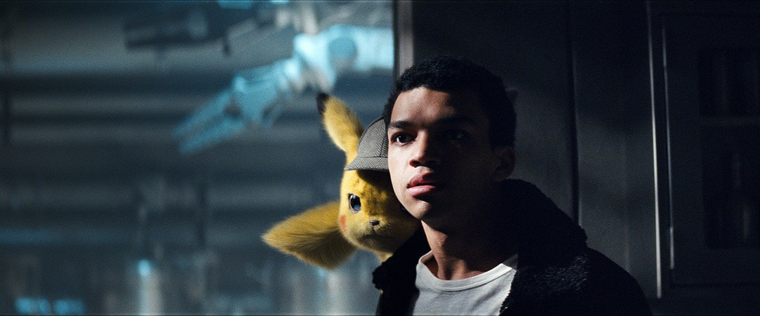 Detective Pikachu (RYAN REYNOLDS) and JUSTICE SMITH as Tim Goodman