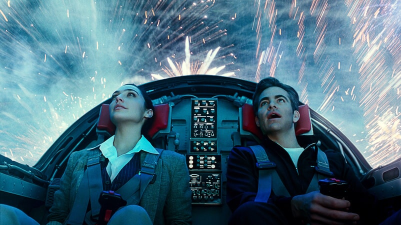 "CHRIS PINE as Steve Trevor and GAL GADOT as Wonder Woman in Warner Bros. Pictures' action adventure ""WONDER WOMAN 1984,"""