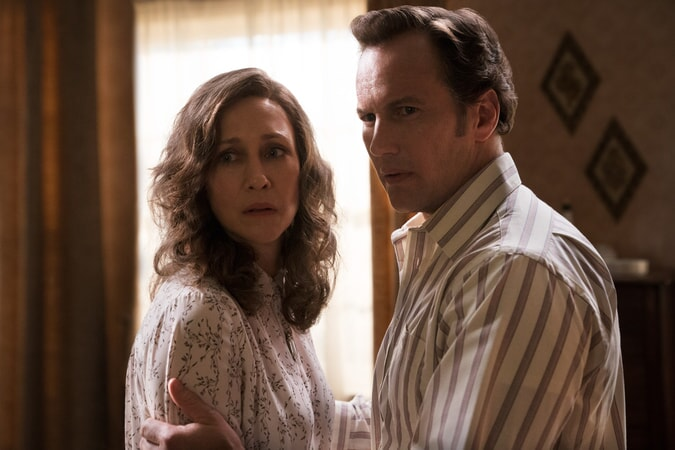 "(L-r) VERA FARMIGA as Lorraine Warren and PATRICK WILSON as Ed Warren in New Line Cinema's horror film ""THE CONJURING: THE DEVIL MADE ME DO IT"""