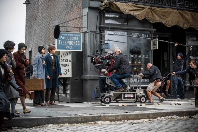 Eddie Redmayne as Newt Scamander and Katherine Waterston as Tina behind the scenes
