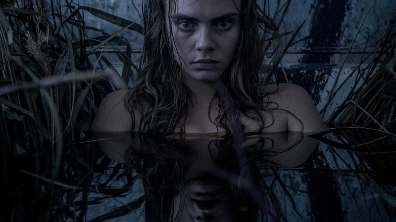 Cara Delevigne as Enchantress coming out of the dark water