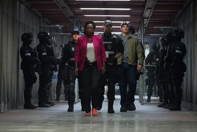 VIOLA DAVIS as Amanda Waller, IKE BARINHOLTZ as Griggs and JOEL KINNAMAN as Rick Flag