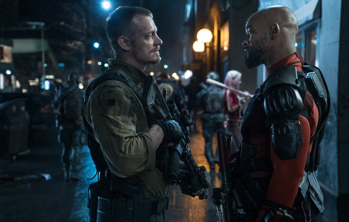 JOEL KINNAMAN as Rick Flag and WILL SMITH as Deadshot
