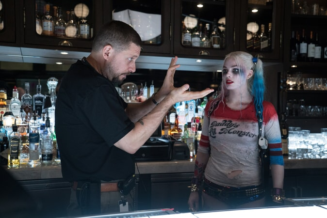 "Writer/director DAVID AYER and MARGOT ROBBIE on the set of Warner Bros. Pictures' action adventure ""SUICIDE SQUAD"""