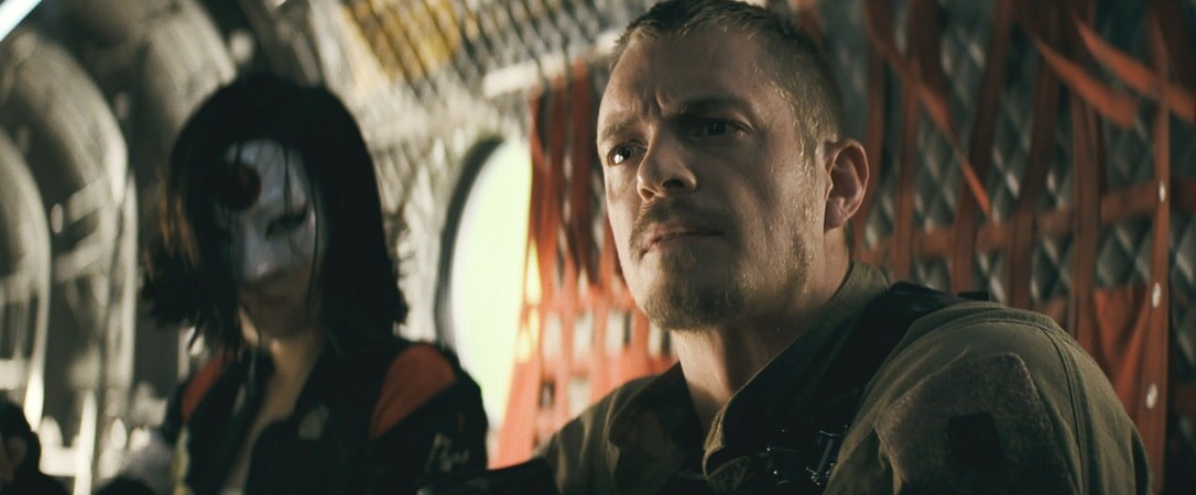 KAREN FUKUHARA as Katana and JOEL KINNAMAN as Rick Flag