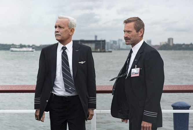 "TOM HANKS as Chesley ""Sully"" Sullenberger and AARON ECKHART as Jeff Skiles"