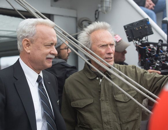 "TOM HANKS with director/producer CLINT EASTWOOD on the set of the upcoming film ""SULLY"""