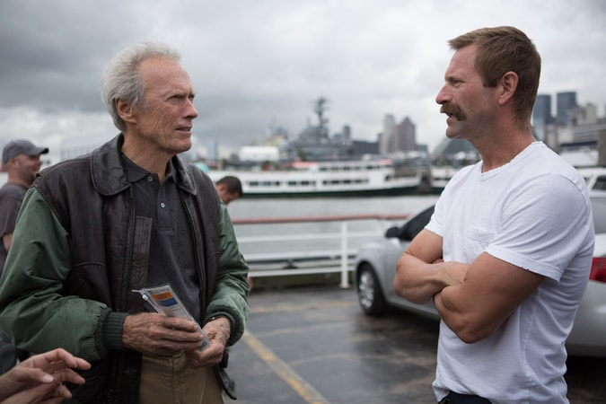 "Director/producer CLINT EASTWOOD and AARON ECKHART on the set of Warner Bros. Pictures' and Village Roadshow Pictures' drama ""SULLY,"" a Warner Bros. Pictures release."