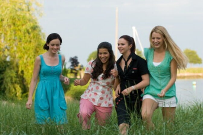 Medium shot of smiling Alexis Bledel as Lena, America Ferrera as Carmen, Amber Tamblyn as Tibby, and Blake Lively as Bridget.