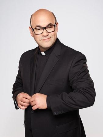 Ian Gomez as Father Gene