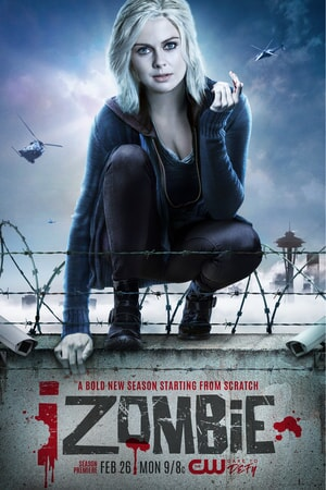 Rose McIver as Liv crouching on a barbed wired stone wall while helicopters hove above