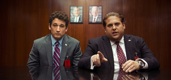MILES TELLER as David and JONAH HILL as Efraim in suits