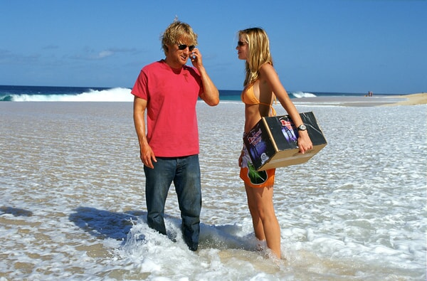 owen wilson and sara foster in the waves in the big bounce
