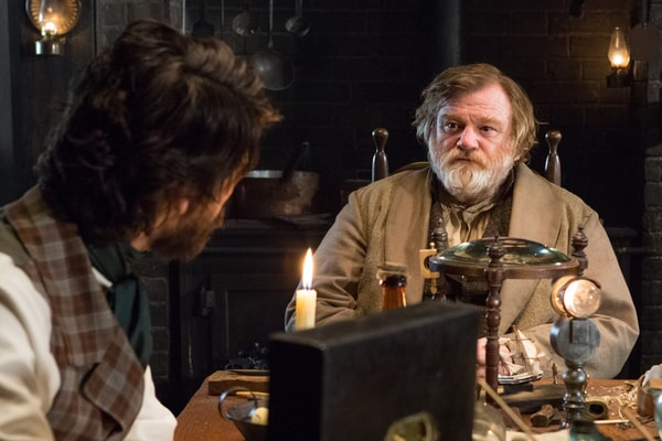 "BEN WHISHAW as Herman Melville and BRENDAN GLEESON as Tom Nickerson in Warner Bros. Pictures' and Village Roadshow Pictures' action adventure ""IN THE HEART OF THE SEA,"" distributed worldwide by Warner Bros. Pictures and in select territories by Village Roadshow Pictures."