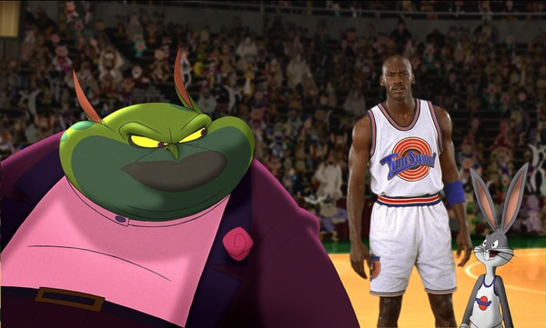 Swackhammer looking back at Michael Jordan and Bugs Bunny; both wearing uniforms.