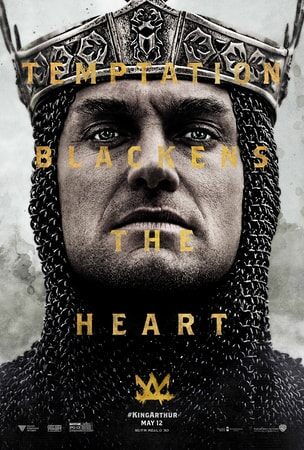 "Close-up of Jude Law as Vortigern with text over his face ""Temptation Blackens The Heart"""