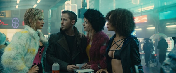 "RYAN GOSLING as K and MACKENZIE DAVIS as Mariette in Alcon Entertainment's action thriller ""BLADE RUNNER 2049,"" a Warner Bros. Pictures and Sony Pictures Entertainment release, domestic distribution by Warner Bros. Pictures and international distribution by Sony Pictures."