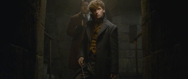 "(L-r) DAN FOGLER as Jacob Kowalski andEDDIE REDMAYNE as Newt Scamander in Warner Bros. Pictures' fantasy adventure ""FANTASTIC BEASTS: THE CRIMES OF GRINDELWALD,"" a Warner Bros. Pictures release."