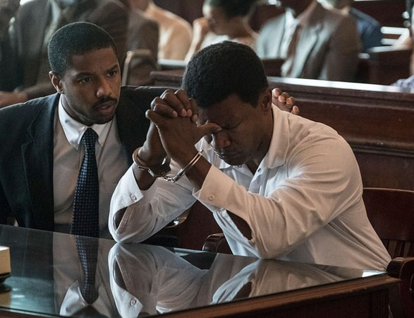 MICHAEL B. JORDAN as Bryan Stevenson and JAMIE FOXX as Walter McMillian