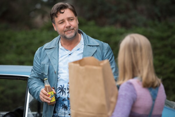 RUSSELL CROWE as Jackson Healy drinking a Yoohoo and ANGOURIE RICE as Holly
