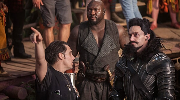 "Director JOE WRIGHT, NONSO ANOZIE and HUGH JACKMAN on the set of Warner Bros. Pictures' and RatPac-Dune Entertainment's action adventure ""PAN,"" a Warner Bros. Pictures release."