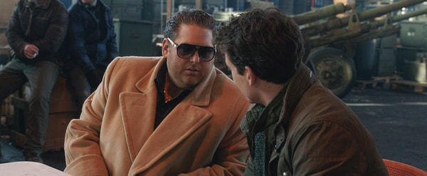 "JONAH HILL as Efraim and MILES TELLER as David in Warner Bros. Pictures' comedic drama (based on true events) ""WAR DOGS,"" a Warner Bros. Pictures release."