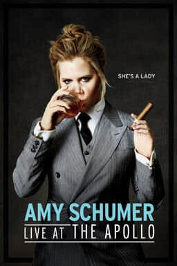 Amy Schumer: Live at the Apollo - Amy Schumer in a grey tuxedo drinking whiskey and smoking a cigar