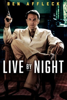 Live by Night - Ben Affleck holding a gun in a white tuxedo in an armchair