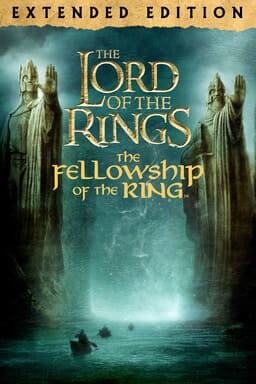 The Lord of the Rings: The Fellowship of the Ring (Extended Edition) - Two statues hand extended