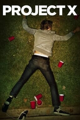 Project X - Boy lying on the ground with red cups around him