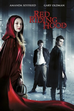 Red Riding Hood - Amanda Seyfried dressed in a red cape in the woods covered in snow with two men