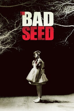 The Bad Seed - Patty McCormack as Rhoda Penmark standing with a white frilly frock in black bg