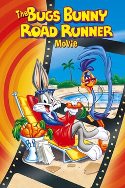 The Bugs Bunny/Road Runner Movie - Bugs Bunny in a red blue robe on beach chair with Road Runner