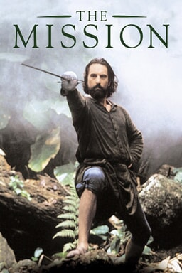 The Mission - Robert De Niro holding fencing sword with leg on rocks pointing forwards