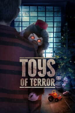 Toys of Terror - Toy monkey with red eyes being carried by little boy with Christmas tree in the background