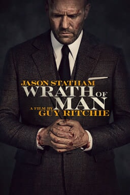 Wrath of Man - Jason Statham and a film by Guy Ritchie - wearing suit with bloody hands clasped