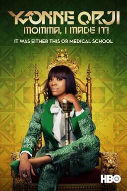 Yvonne Orji: Momma, I Made It! - Yvonne Orji in green patterned tux sitting on golden throne w mic
