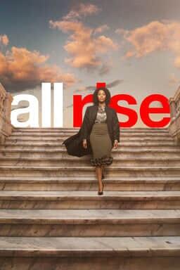 All Rise: Season 2 - Simone Missick as Lola Carmichael walking down marble stairs