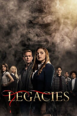 "Legacies: Season 2 - Cast standing in V formation with smokey mist and black background with ""Legacies"" in gold and red ribbon"