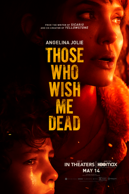 Those Who Wish Me Dead - Angelina Jolie looking off to the right in a red yellow light and boy below